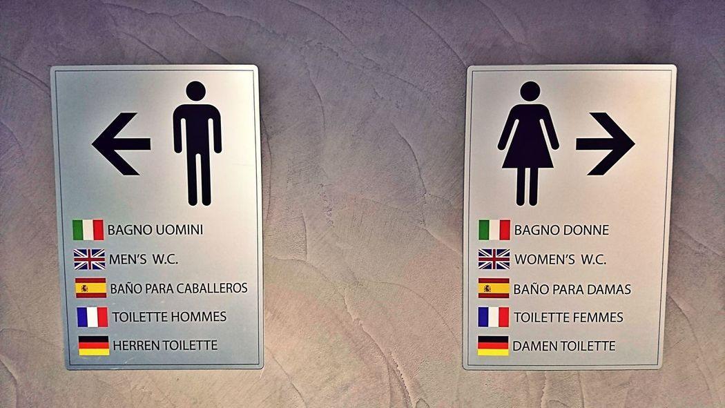 Highlighting your Next turn Communication Human Representation Doorways Direction Signs Men Woman Restroom Sign Text Orientation