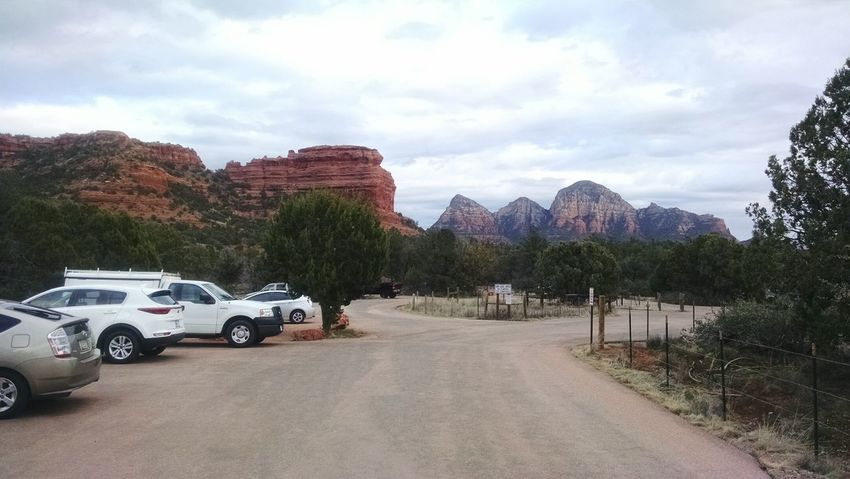 Car Transportation Mode Of Transport Road Driving Cloud - Sky Land Vehicle Stationary Sky Tree Mountain Outdoors Day Nature No People Trailhead Sedona Arizona Tranquility Boynton Canyon Beauty In Nature Red Forest Landscape Lost In The Landscape