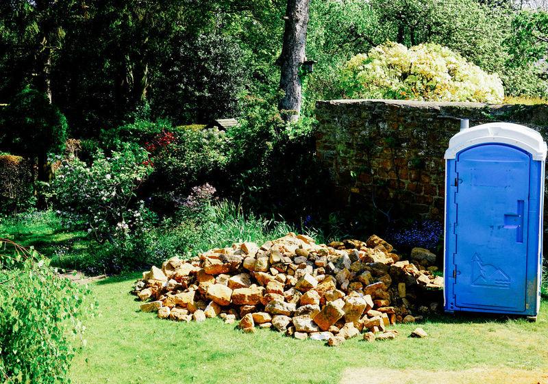 Banbury Country Life Day England English Countryside English Garden Garden Photography Grass Nature No People Outdoors Plant Portaloo Rental Toilet Rubble Stones Toilet Tree Workmen