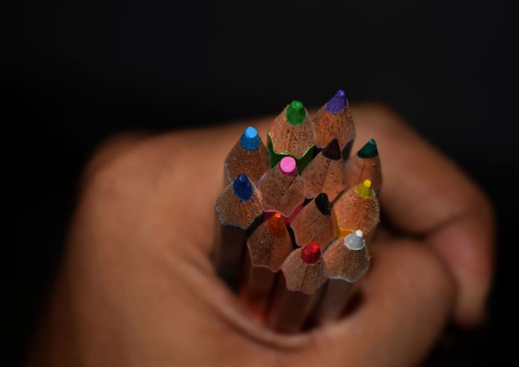 handful of colour pencils Multi Colored Human Hand Childhood Child Close-up Pencil Shavings Craft Product Art And Craft ArtWork Colored Pencil Art And Craft Equipment Pencil Art Craft