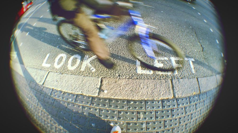 Watch out...!! On The Way Need For Speed Telling Stories Differently Up Close Street Photography Too Close For Comfort Cyclist Crossing Unexpectedly Dangerously Close Unexpected Embrace Urban Life Waiting Game