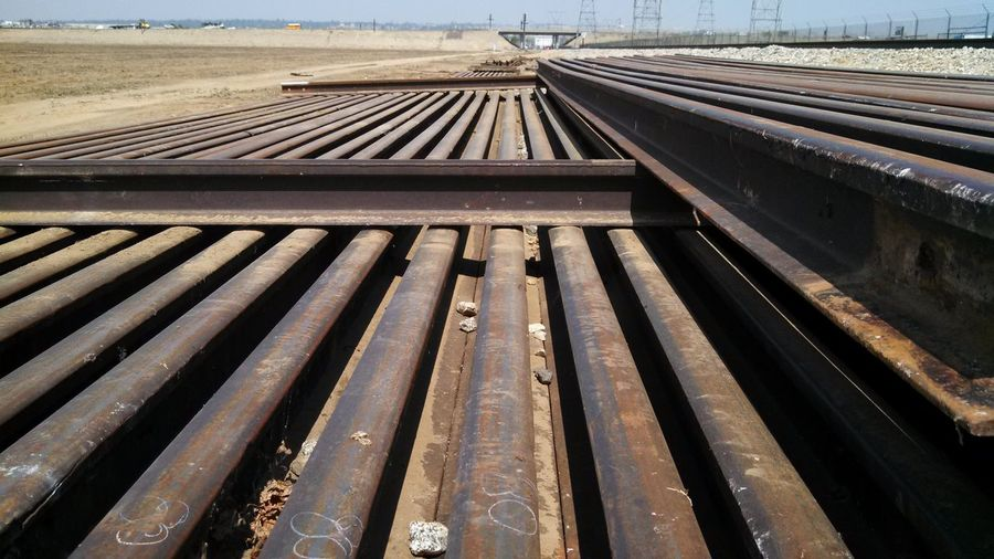 Built Structure Connection Day Diminishing Perspective High Angle View Metal No People Outdoors Public Transportation Rail Transportation Railing Railroad Station Railroad Station Platform Railroad Track Railway Track Road The Way Forward Transportation Travel Vanishing Point