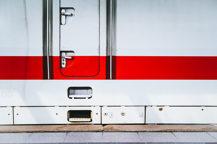 Close-up of white and red train