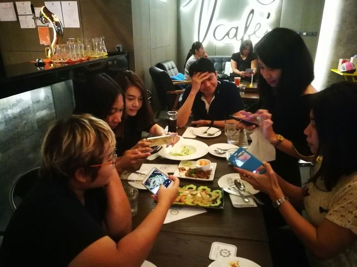 Mobile Conversations Friendship Eating Indoors  Young Women Young Adult Mobile Phone Togetherness Food Social Gathering Sitting Adults Only Real People Fun Medium Group Of People Adult People Party - Social Event Drink Community