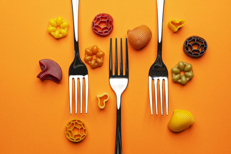 Directly above shot of various food against orange background