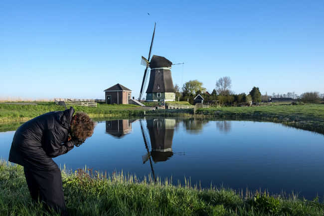 Amsterdam Blue Sky Flevoland Friesland Friesland Sky Grass Grassy Holland Holland❤ Landscape Nature Netherlands Outdoors Photographer Taking Pictures Photogrpher Reflection Tranquil Scene Tranquility West Friesland Netharlands Windmill Windmill Of The Day Windmill Reflection Windmills Windmills #photography Windmills Photography