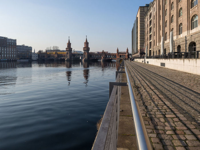 View of oberbaumbrücke at waterfront of spree river in berlin, germany