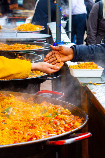 Man preparing food at market stall