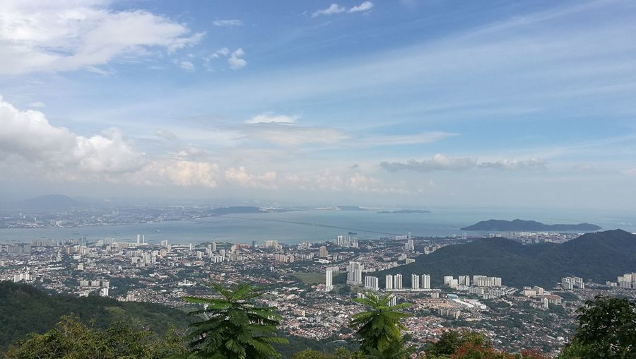 Penang Island Penang Cityscape City Cloud - Sky High Angle View Building Exterior Business Finance And Industry Architecture Downtown District Outdoors Urban Sprawl Urban Skyline Horizon Over Water Skyscraper Aerial View Modern Sky No People Hill Horizon Landscape Built Structure Residential Building Residential District Community Crowded Day Mountain Residential  Tree