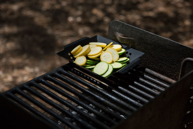 High angle view of sliced vegetables in barbeque grill at park