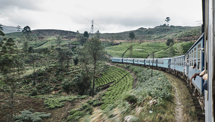 Panoramic view of train on mountain against sky