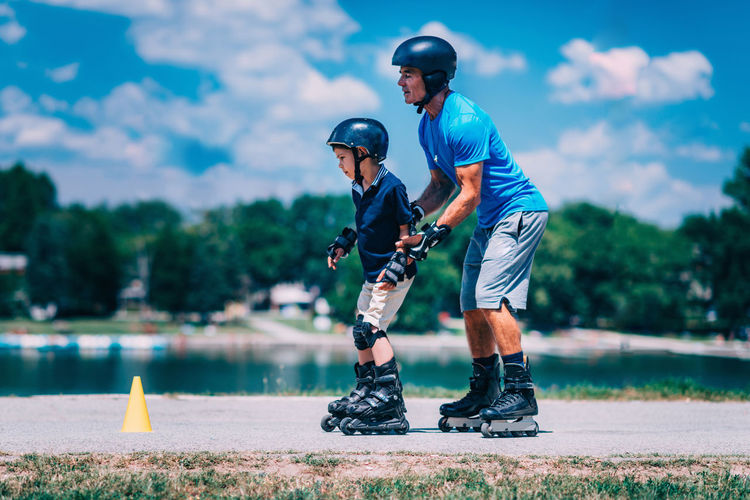Roller Skating Rollerskating Grandfather Grandson Roller Sport Outdoor Kid Fun Child Instructor Cones Active Ride Rollerblading Learning Teaching Roller Skating Senior Skate Young Happy Blade Rollerblade Road Boy Summer Skater Park Activity Smile Helmet Blades Rollerblader Family Protector Pads Knee Pads Recreation  Protection Safe Sporty Enjoy Rollerblades Balance Old Man People Roller Skate Day