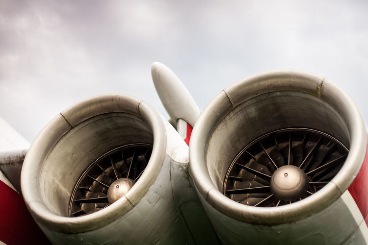 Low angle view of jet engine against sky