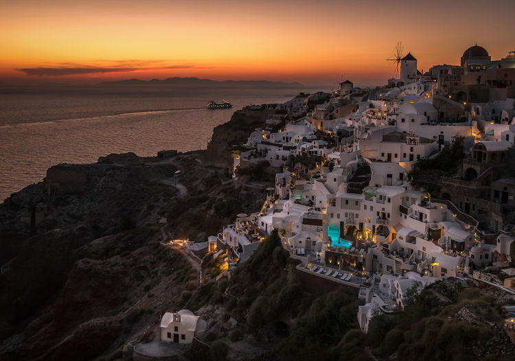 High Angle View Of Oia Village By Sea At Santorini During Sunset