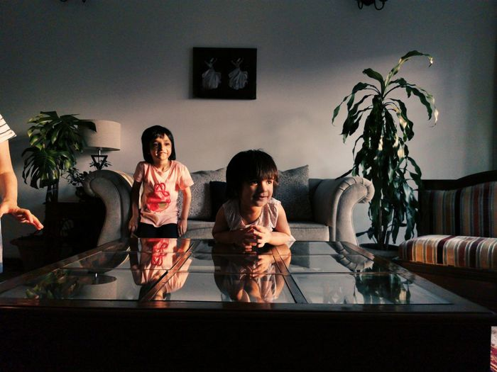 Women sitting on sofa at home