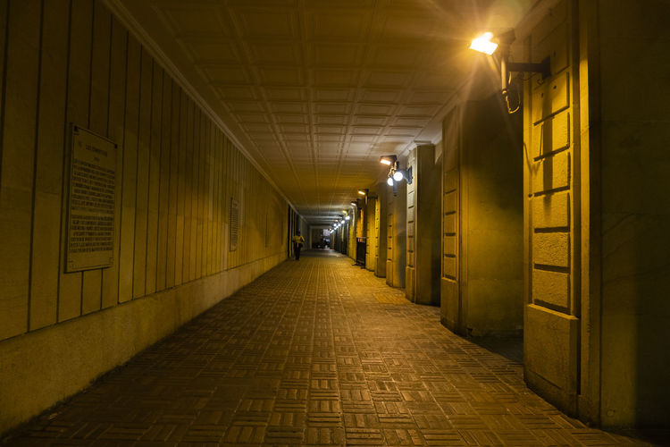 The Way Forward Direction Illuminated Architecture Lighting Equipment Built Structure Diminishing Perspective Footpath Building No People Night Empty Yellow Street Building Exterior Glowing Outdoors Cobblestone City Light Alley Paving Stone Ceiling Long