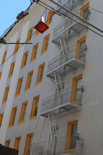 Architecture Balcony Building Exterior Built Structure City Contrast Day Fire Escape Low Angle View No People Outdoors Railing Residential Building Sky Staircase Steps Steps And Staircases Street Photography Window