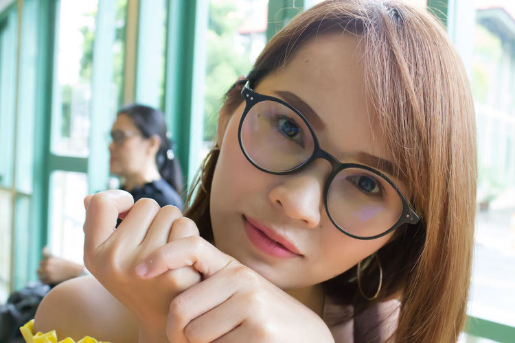 Good Day Beautiful Woman Close-up Eyeglasses  Females Focus On Foreground Front View Girls Glasses Hairstyle Headshot Holding Leisure Activity Lifestyles Looking At Camera One Person Portrait Real People Women Young Adult Young Women