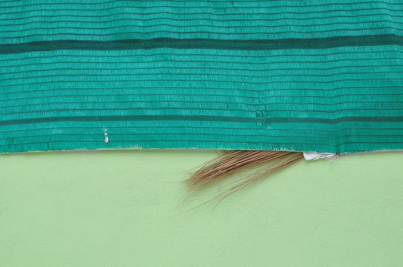High angle view of broom and textile on floor
