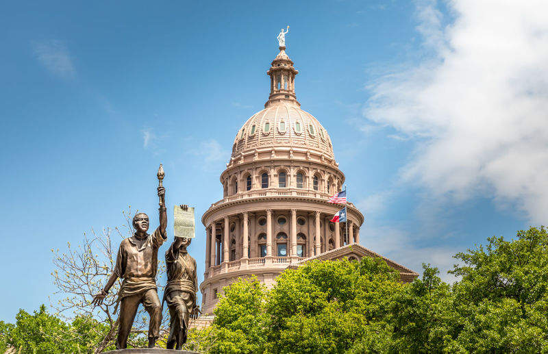 African-American-Monument and the Texas State Capitol Texas Capitol Austin State Building African American Monument Capital Sky Day Downtown Dome Government Travel Blue Capitol Architecture City USA Landmark Monument Congress Old Historic Flag Federal Tourism Stone Cloud Statue America Law Politics United Legislature  TX Political Symbol Spring Space Green