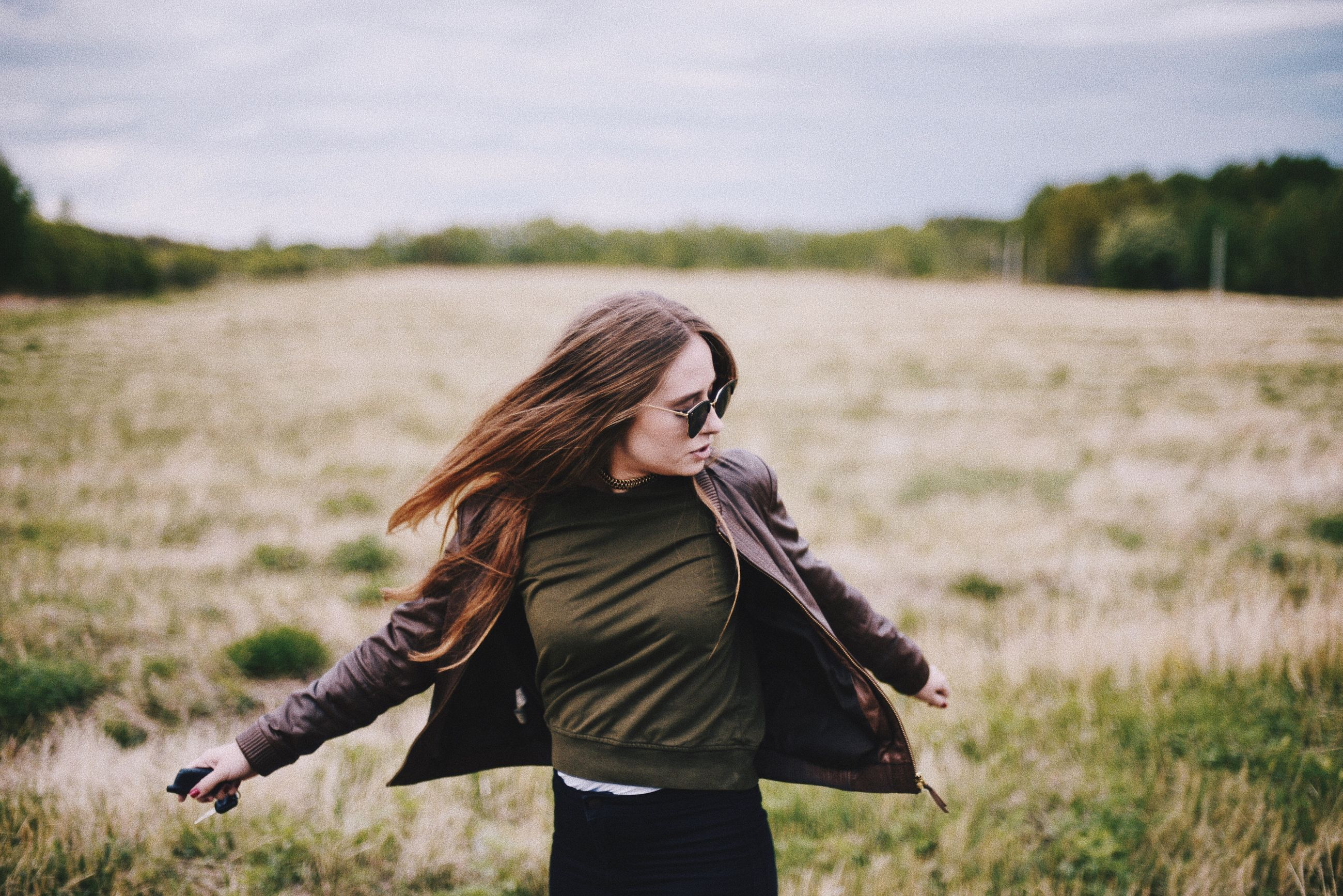 one person, real people, young adult, leisure activity, focus on foreground, field, nature, casual clothing, young women, lifestyles, walking, long hair, landscape, outdoors, standing, day, sky, women, grass, beautiful woman, beauty in nature, tree, people