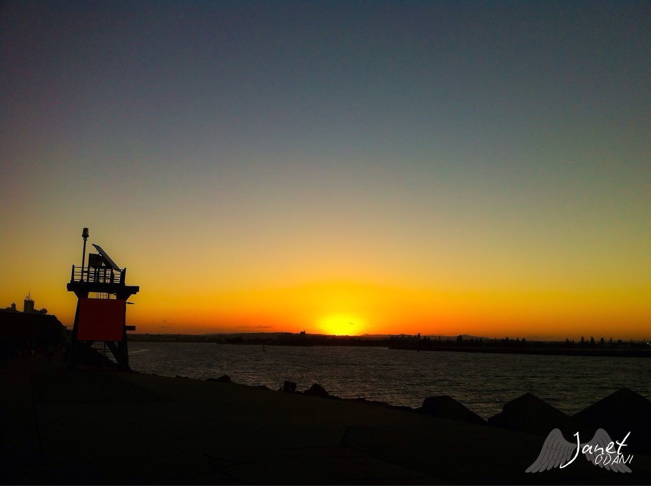 sunset, sea, silhouette, beach, sky, water, scenics, nature, tranquility, outdoors, beauty in nature, horizon over water, no people, built structure, clear sky, architecture, nautical vessel, day