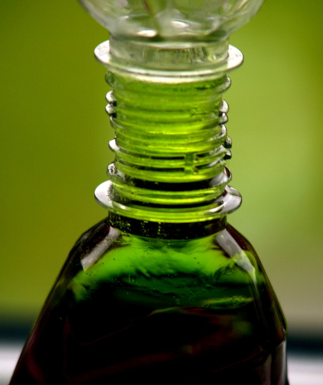 bottle, green color, close-up, focus on foreground, table, no people, indoors, freshness, drink, alcohol, water, nature, day