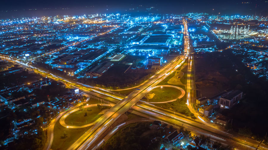 Twilight landscape ring road inter city and lightning cityscape background at night aerial view