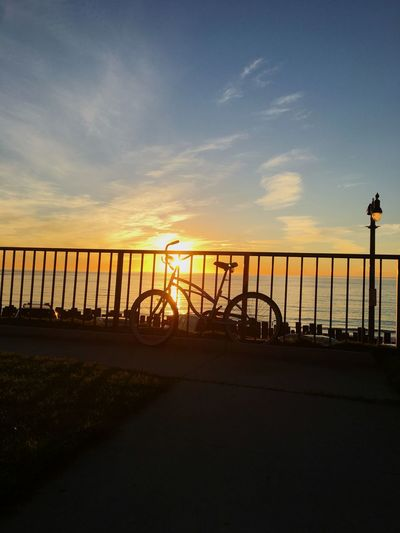 Sunset Sky Railing Sea Silhouette Cloud - Sky Nature Outdoors Scenics Beauty In Nature Tranquil Scene Water Bicycle No People Beach Horizon Over Water Tranquility Day