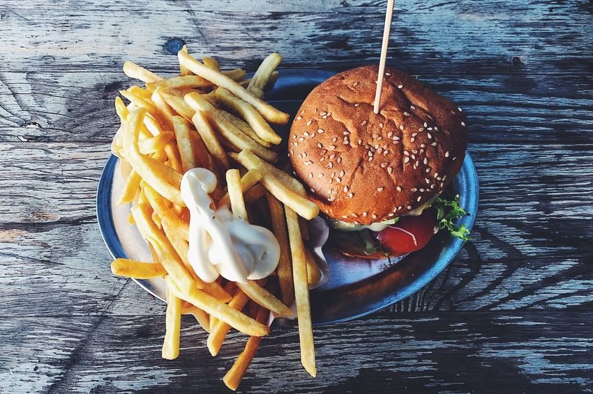 Food Food And Drink Ready-to-eat Still Life Fast Food Table Freshness Unhealthy Eating High Angle View No People French Fries Burger Indoors  Potato Prepared Potato Fried Directly Above Close-up Hamburger Indulgence