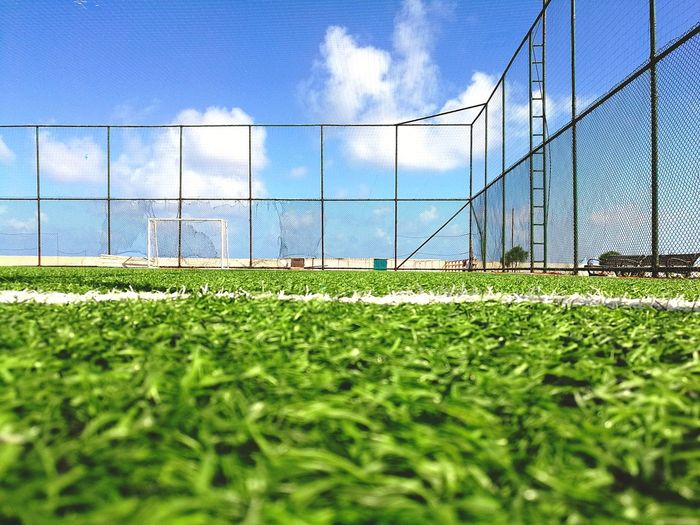 Targeted Target Sea Football Soccer Field Sport Sky Architecture Grass Built Structure Cloud - Sky Green Color Goal Post Soccer Goal Playing Field Yard Line - Sport Soccer Player Turf Goal Soccer Surface Level Chainlink Fence