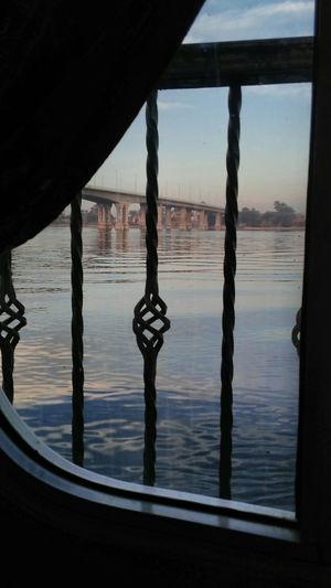 Room view Water Reflection Silhouette Built Structure Sky City Nile Boats Vacations Enjoying Life Aswan,Egypt Hello World Taking Photos That's Me Nature Outdoors Clear Sky Nile_view River Beauty Travel