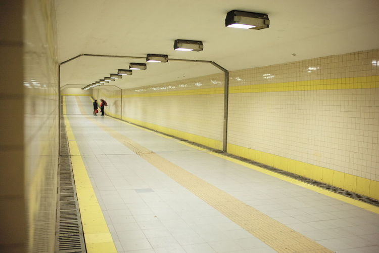 People standing in illuminated subway