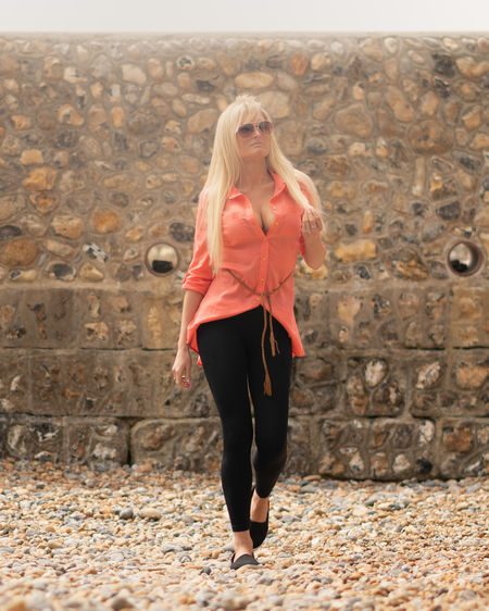 Sunlit walk on the beach in Brighton Blonde Brighton Brighton Beach Calm Holiday Pebble Beach Strolling Sunlight Sunny Walk Adult Beautiful Woman Blond Hair Casual Clothing Clothing Full Length Hair Healthy Lifestyle Orange Color Relaxed Moments Shirt Stone Wall Sunglasses Sunlight And Shadow Walking On The Beach The Fashion Photographer - 2018 EyeEm Awards