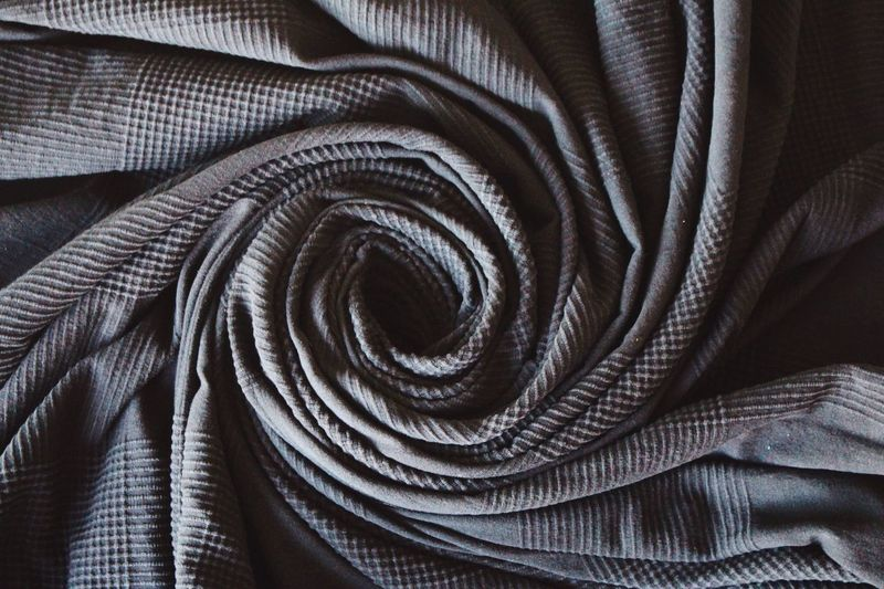 Turn around...around...around... The Creative - 2018 EyeEm Awards Creative space Getting Inspired Exceptional Photographs The Still Life Photographer - 2018 EyeEm Awards Pattern Indoors  No People Textile Full Frame Backgrounds Close-up Still Life Textured  Spiral High Angle View Black Color Rolled Up Large Group Of Objects Stack Metal Wrinkled Furniture Rope Absence
