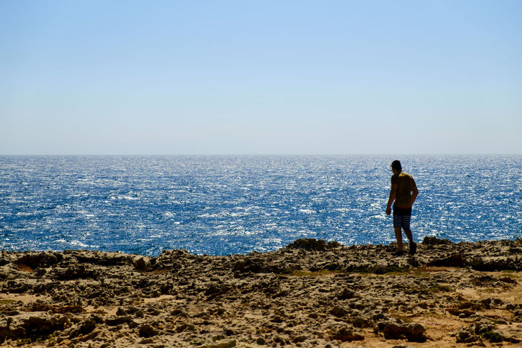 Beach Clear Sky Full Length Grotta Della Poesia Horizon Over Water Italy Lecce Leisure Activity Looking At View Melendugno One Man Only One Person Only Men Puglia Rear View Rock - Object Salento Salento Puglia Sea Silhouette Solitude Standing Tranquil Scene Travel Destinations Vacations