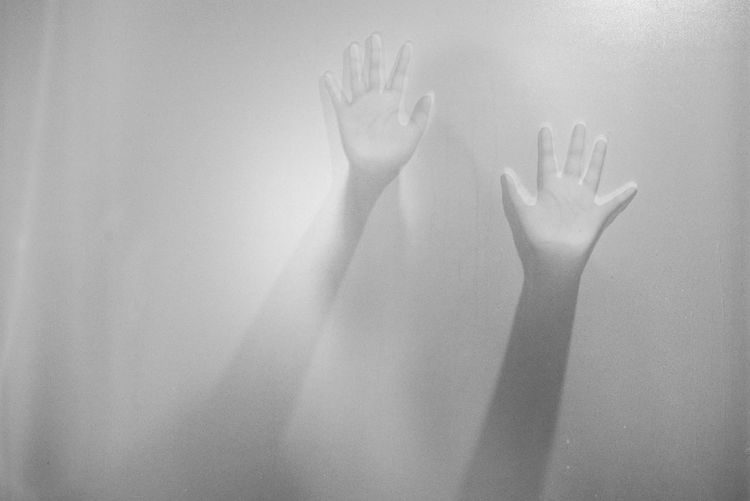 Shadow hands of the woman behind frosted glass.Blurry hand abstraction.Halloween background.Black and white picture Adult Body Part Close-up Day Finger Hand Human Body Part Human Finger Human Hand Human Limb Indoors  Leisure Activity Lifestyles One Person Real People Shadow Touching Unrecognizable Person Wall - Building Feature Women