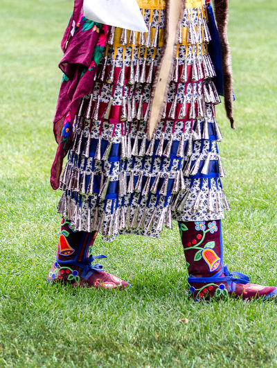 september 3, 2017, an American Indian girl in a jingle dress dances during a competition at the Kee-Boon-Mein-Kaa Pow Wow in Dowagiac Michigan USA Fashion Michigan Pow Wow Dancer Pow Wow USA America American Indian Bells Celebration Clothing Colorful Competition Editorial Photography Female Girl Hand Made Jingle Dress Musical Native American Outdoors People Regalia Traditional Clothing Vertical Women