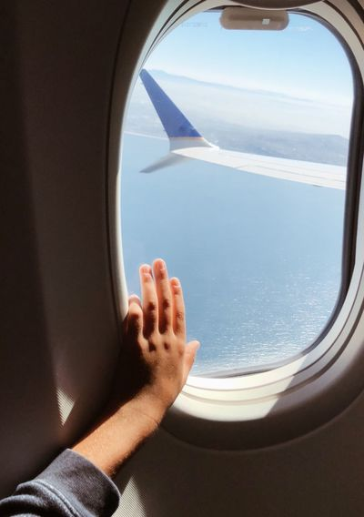 Wonder of flying Up In The Sky Airplane Window View Airplane Wing Touch Wanderlust Wonder Flying High Circle Window Childhoold Adventure Roam Joy Boy Human Body Part Body Part Window One Person Transportation Real People Mode Of Transportation Lifestyles Nature Glass - Material Air Vehicle