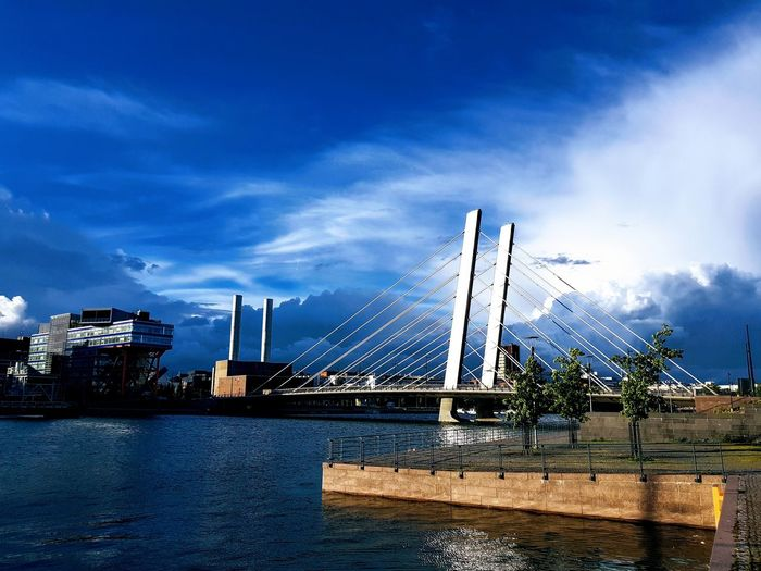 Bridge - Man Made Structure Sky Cloud - Sky Suspension Bridge Outdoors Connection Water No People Transportation Day Nautical Vessel Tall Ship Built Structure Architecture City Sea Nature Sailing Ship Blue
