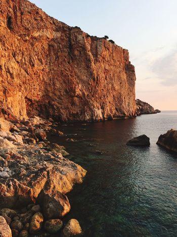Morningsun Sunset Water Sky Beauty In Nature Sea Rock Tranquility Tranquil Scene Nature Solid Scenics - Nature No People Rock - Object Mountain Rock Formation Non-urban Scene Outdoors Land