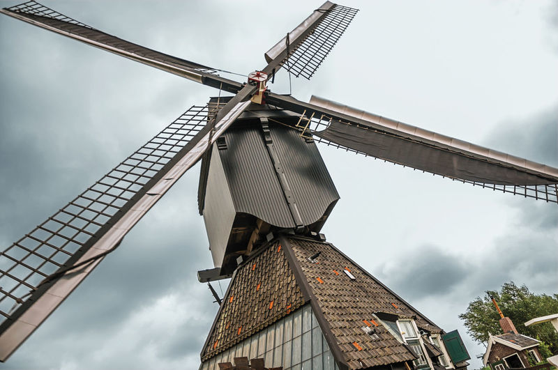 Close-up of windmill blades in a cloudy day at kinderdijk. a polder the country of netherlands.