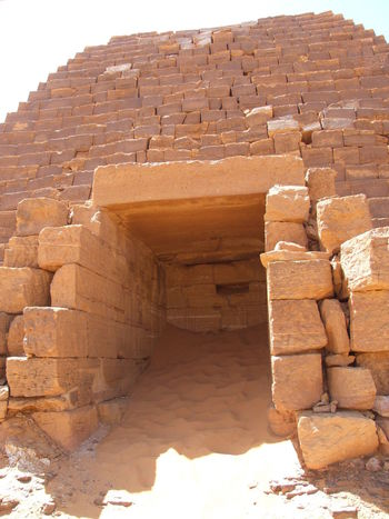 An open burial chamber of a Meroite Nubian pyramid , Sand piled up inside Architecture Bajrawiya Built Structure Burial Chamber History Meroite Pyramids Nubian Architecture Open Outdoors Sand Piled Up Insi Stone Material Sudan Khartoum