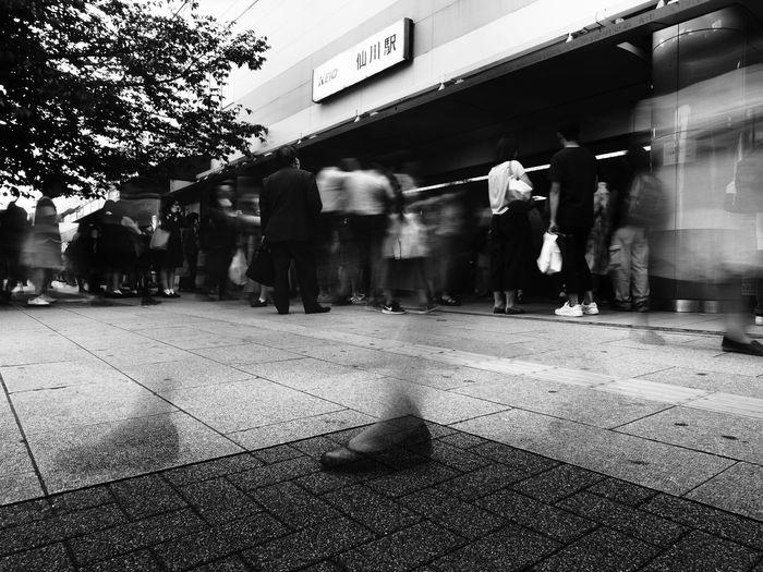 人身事故で電車が止まってしまった京王線仙川駅にて久々に足跡シリーズ👣 Olympus OM-D E-M5 Mk.II Tokyo Street Photography Monochrome Blackandwhite FootPrint Architecture City Real People Group Of People Men Built Structure Walking Street Blurred Motion Motion People City Life Women