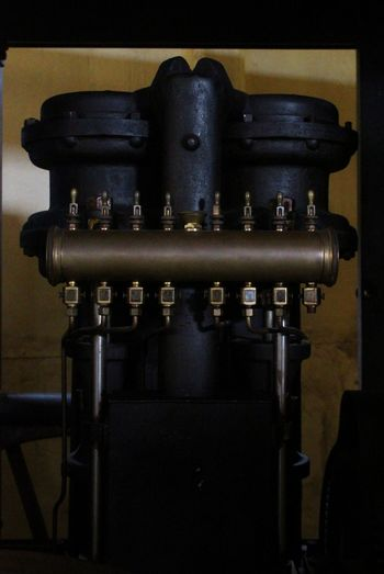 Vaccum motor 1906 Motor Vaccumcleaner One Tone Brass Castle Old Heavy Equipment Sweden Manufacturing Equipment Business Finance And Industry Factory Close-up Historic Civilization Historic Building The Past Brass Instrument
