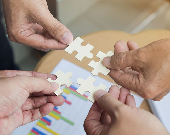 Group of business people assembling jigsaw puzzle wanting to put pieces of puzzle together on wood table backgroung for help support, teamwork concept Business Man SLICE SUPPORT Teamwork Thinking Connect Connection Cooperation Cooperation Team Work Drive Holding Jigsaw Piece Jigsaw Puzzle Join Match People Pieces Problem Puzzle  Puzzle  Solve Strategy Teamwork Together