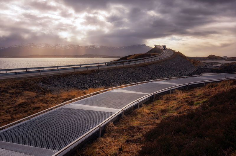 Scenic view of road against sky during sunset norway