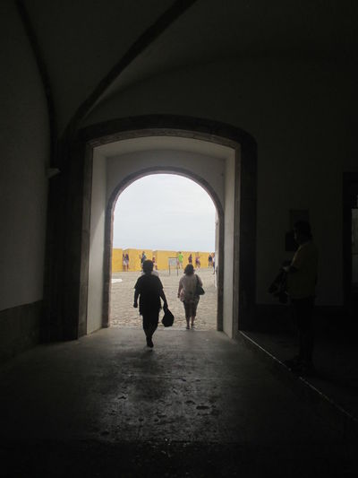 Adult Arch Architecture Darkness And Light Day Fortress On The Inside Full Length Historical Place Indoors  Men Monument Peniche Fortress Peniche, Portugal People People Visiting The Fortress Portuguese History Real People Silhouette Togetherness Tourists Tourists Walking Two People Walking Women Yellow Wall