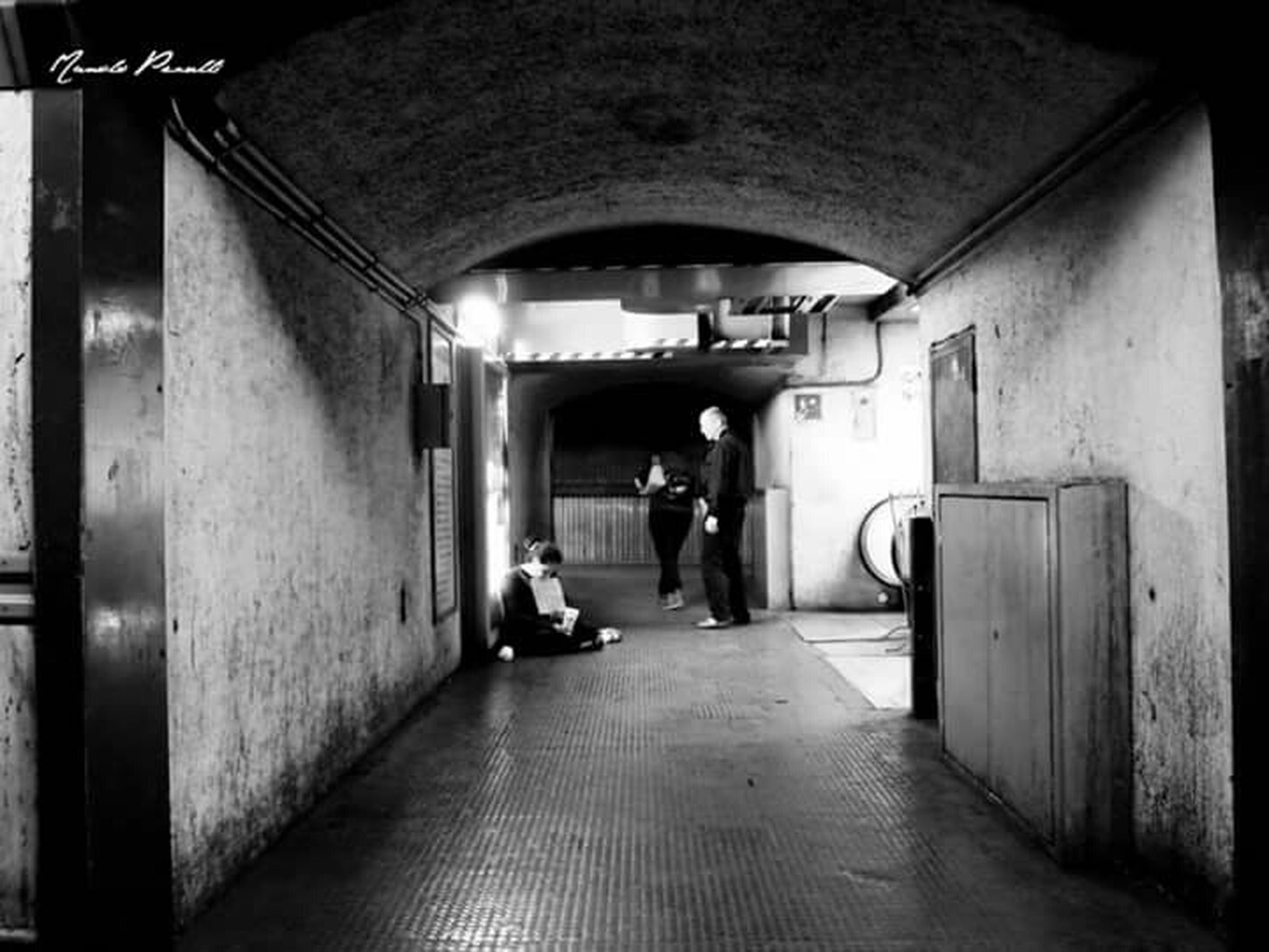 indoors, the way forward, architecture, men, arch, walking, rear view, built structure, full length, tunnel, lifestyles, corridor, diminishing perspective, person, transportation, archway, narrow