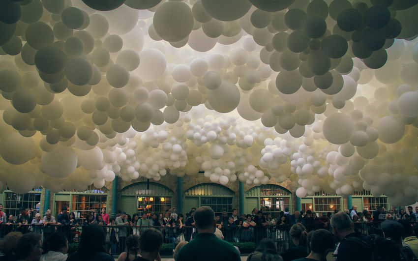 A crowd gathers as the excitement builds.. Plooms of balloons float overhead like bubbles. Let the celebrations begin. Atmosphere Bubbles Event Fun Gathering Adult Architecture Balloon Balloons Balloons🎈 Bubble Celebration City Cloud - Sky Crowd Day Group Of People Large Group Of People Leisure Activity Lifestyles Men Real People Women